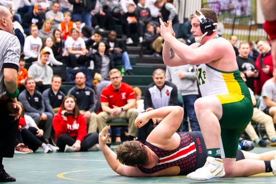 Cedar Rapids Kennedy's Josh Vis, right, celebrates after pinning Iowa City High's Jacob Murry at 285 during the Mississippi Valley Conference wrestling super meet tournament on Saturday, Jan. 26, 2019, at West High School in Iowa City, Iowa. Vis scored a fall over City High's Murry in 3:15.