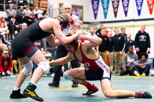 Linn-Mar's Jacob Wempen, left, wrestles Western Dubuque's Devin Ludwig at 182 during the Mississippi Valley Conference wrestling super meet tournament on Saturday, Jan. 26, 2019, at West High School in Iowa City, Iowa. Wempen scored a decision over Western Dubuque's Ludwig, 4-3.