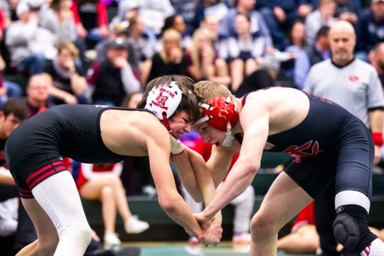 Linn-Mar's Brandon O'Brien, left, is one of Iowa's best pound-for-pound wrestlers. He won a Junior folkstyle national title in March, and won both the Junior freestyle and greco state titles last weekend.