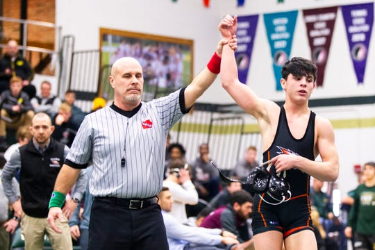 Cedar Rapids Prairie's Austin Kegley has his hand raised after scoring a major decision at 113 during the Mississippi Valley Conference wrestling super meet tournament on Saturday, Jan. 26, 2019, at West High School in Iowa City, Iowa. Kegley scored a major decision over Western Dubuque's Dawson Bierman, 15-5.