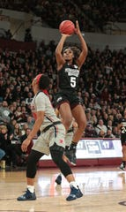 Mississippi State's Anriel Howard puts up a shot in the second quarter of the Bulldogs win over Ole Miss on Sunday Jan. 27. Photo by Keith Warren