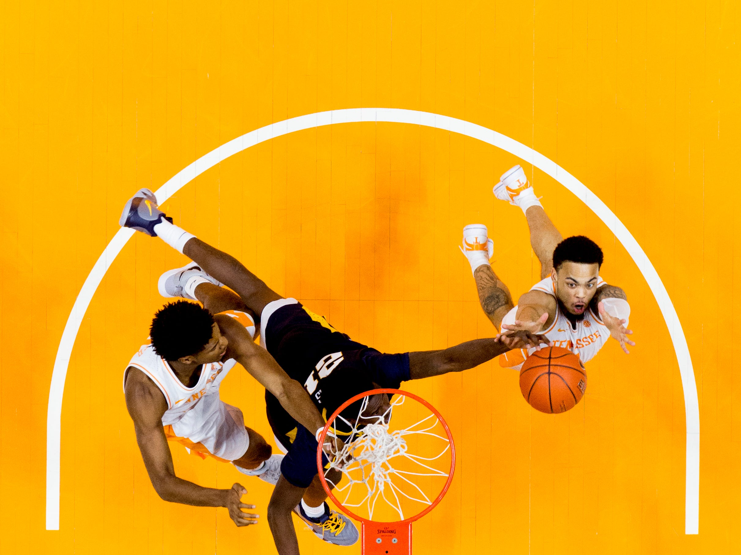Tennessee guard Jordan Bone (0) grabs the rebound from West Virginia forward Wesley Harris (21) during a SEC/Big 12 Challenge game between Tennessee and West Virginia at Thompson-Boling Arena in Knoxville, Tennessee on Saturday, January 26, 2019.