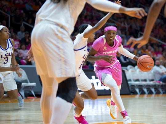 Tennessee's Rennia Davis (0) drives toward the basket while guarded by LSU's Shanice Norton (2) on Sunday.