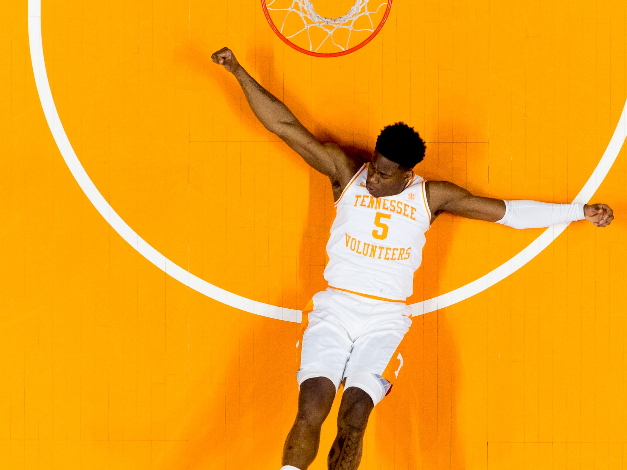 Tennessee guard Admiral Schofield (5) falls to the ground during a SEC/Big 12 Challenge game between Tennessee and West Virginia at Thompson-Boling Arena in Knoxville, Tennessee on Saturday, January 26, 2019.