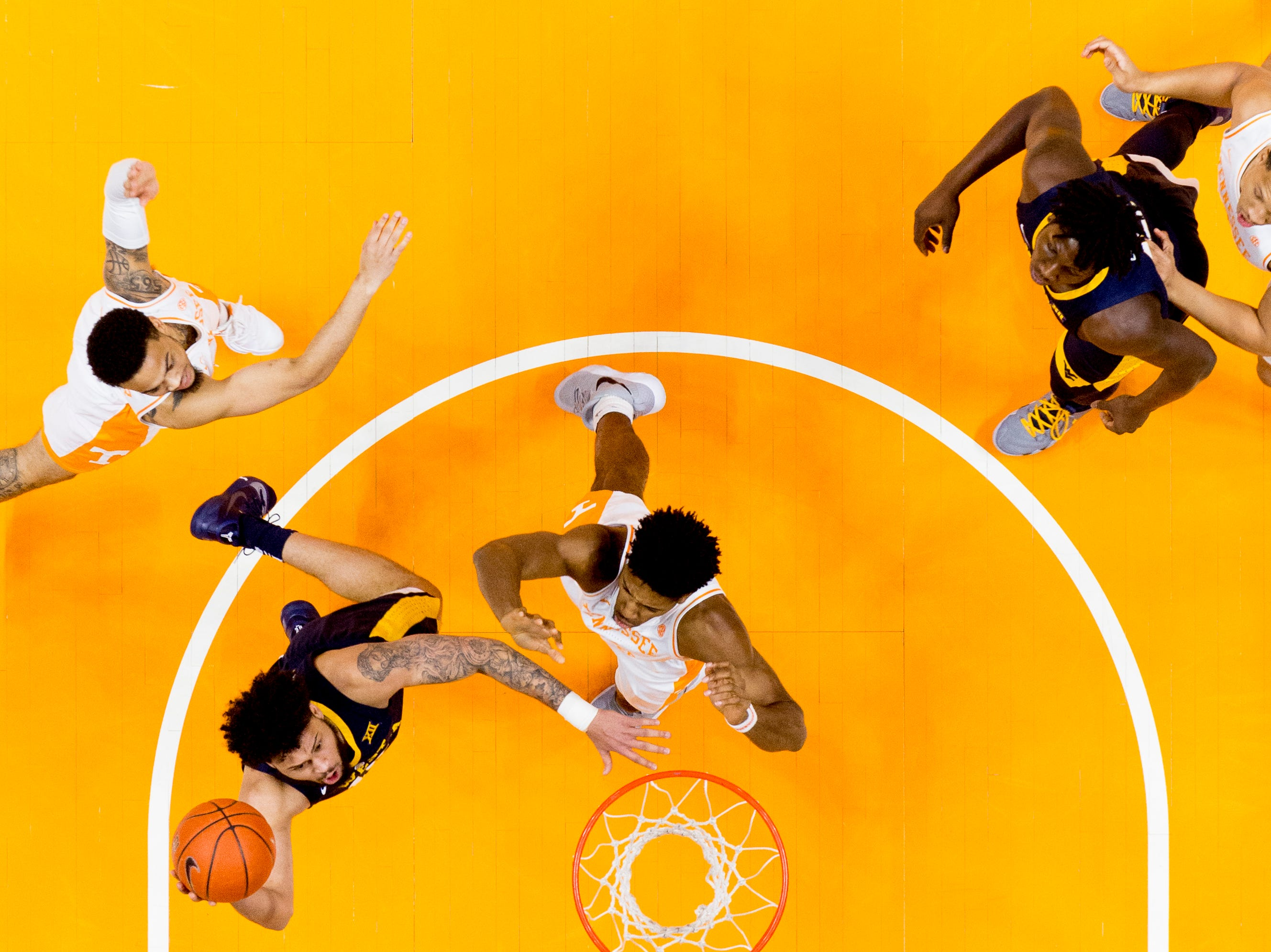 West Virginia guard Jermaine Haley (10) goes for a layup during a SEC/Big 12 Challenge game between Tennessee and West Virginia at Thompson-Boling Arena in Knoxville, Tennessee on Saturday, January 26, 2019.