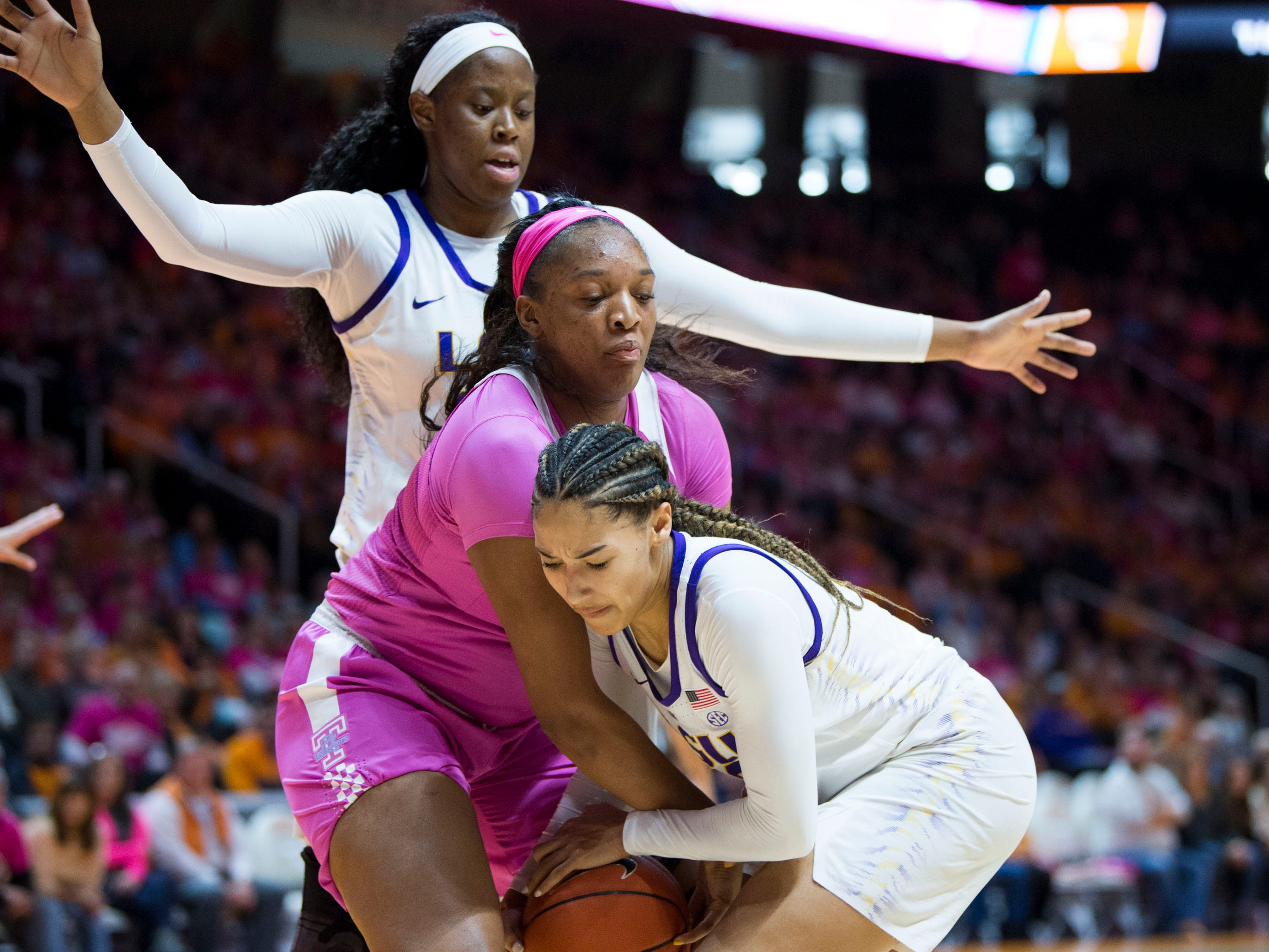 Tennessee's Kasiyahna Kushkituah (11) and LSU's Mercedes Brooks (12) try to gain control of the ball on Sunday, January 27, 2019.