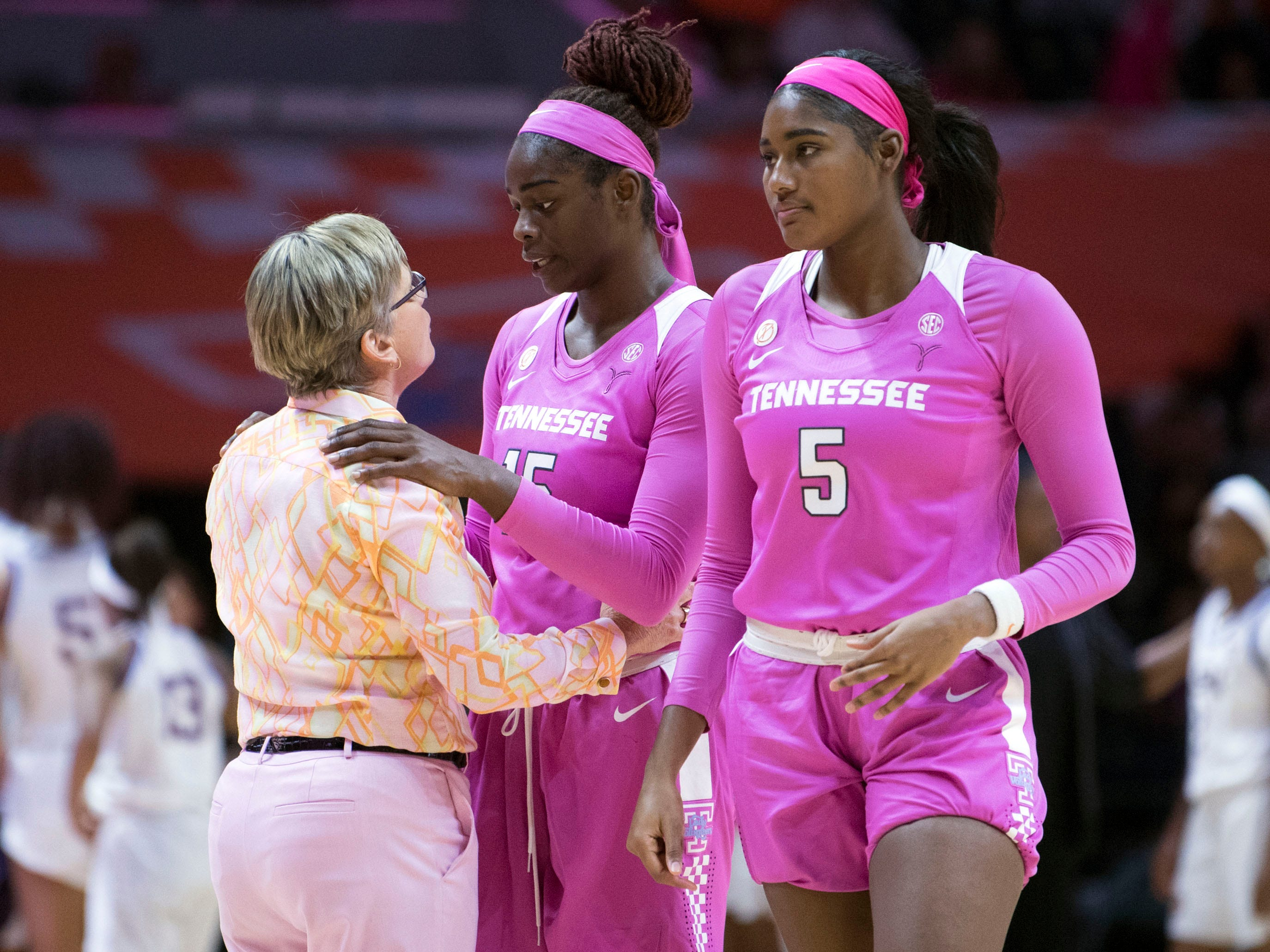 Tennessee women's basketball coach Holly Warlick talks with Cheridene Green (15) during a time out in the game against LSU on Sunday, January 27, 2019. At right is TennesseeÕs Kamera Harris (5).