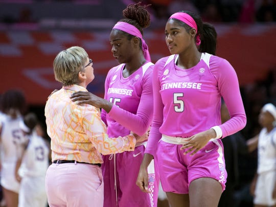 Tennessee women's basketball coach Holly Warlick talks with Cheridene Green (15) during a timeout in the game against LSU on Sunday.