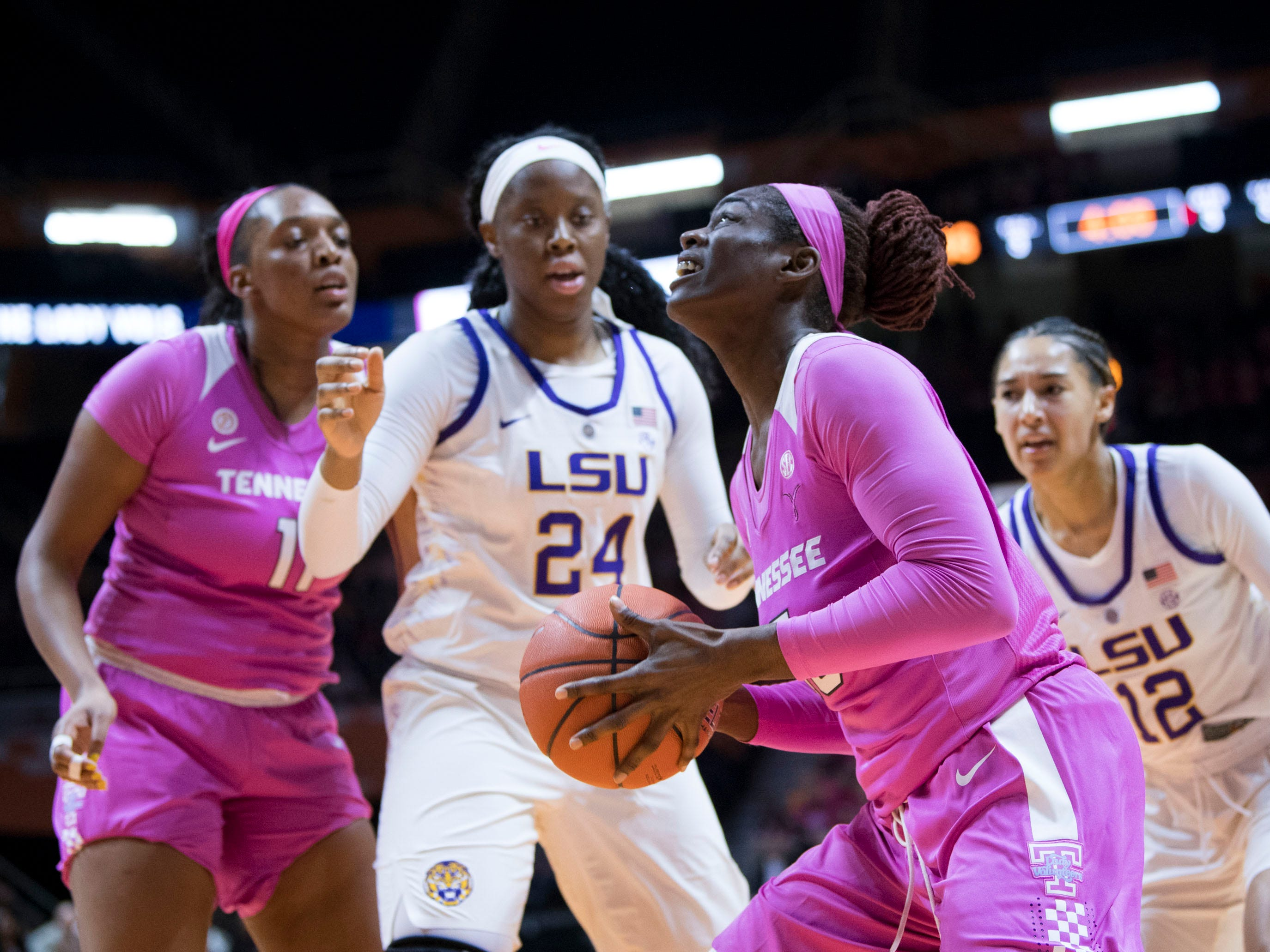 Tennessee's Cheridene Green (15) looks to the basket while guarded by LSU's Faustine Aifuwa (24) on Sunday, January 27, 2019.