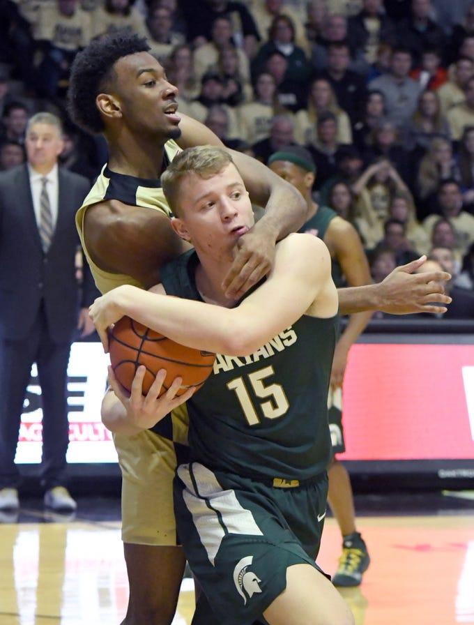 Purdue's Aaron Wheeler ties up MSU's Thomas Kithier in West Lafayette on Sunday January 27, 2019. Purdue upset the Spartans 73-63.