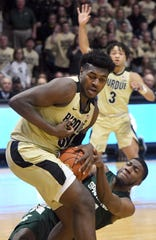 Purdue's Trevion Williams wrestles the ball away from MSU's Aaron Henry in West Lafayette on Sunday January 27, 2019. Purdue upset the Spartans 73-63.