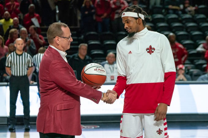 UL's head basketball coach Bob Marlin congratulates JaKeenan Gant before the game as the Ragin' Cajuns take on the Troy Trojans at the Cajundome on Jan. 26, 2019.