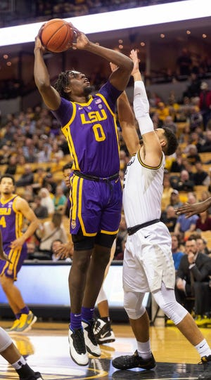 LSU's Naz Reid, left, shoots over Missouri's K.J. Santos, right, during the first half of an NCAA college basketball game Saturday, Jan. 26, 2019, in Columbia, Mo. (AP Photo/L.G. Patterson)
