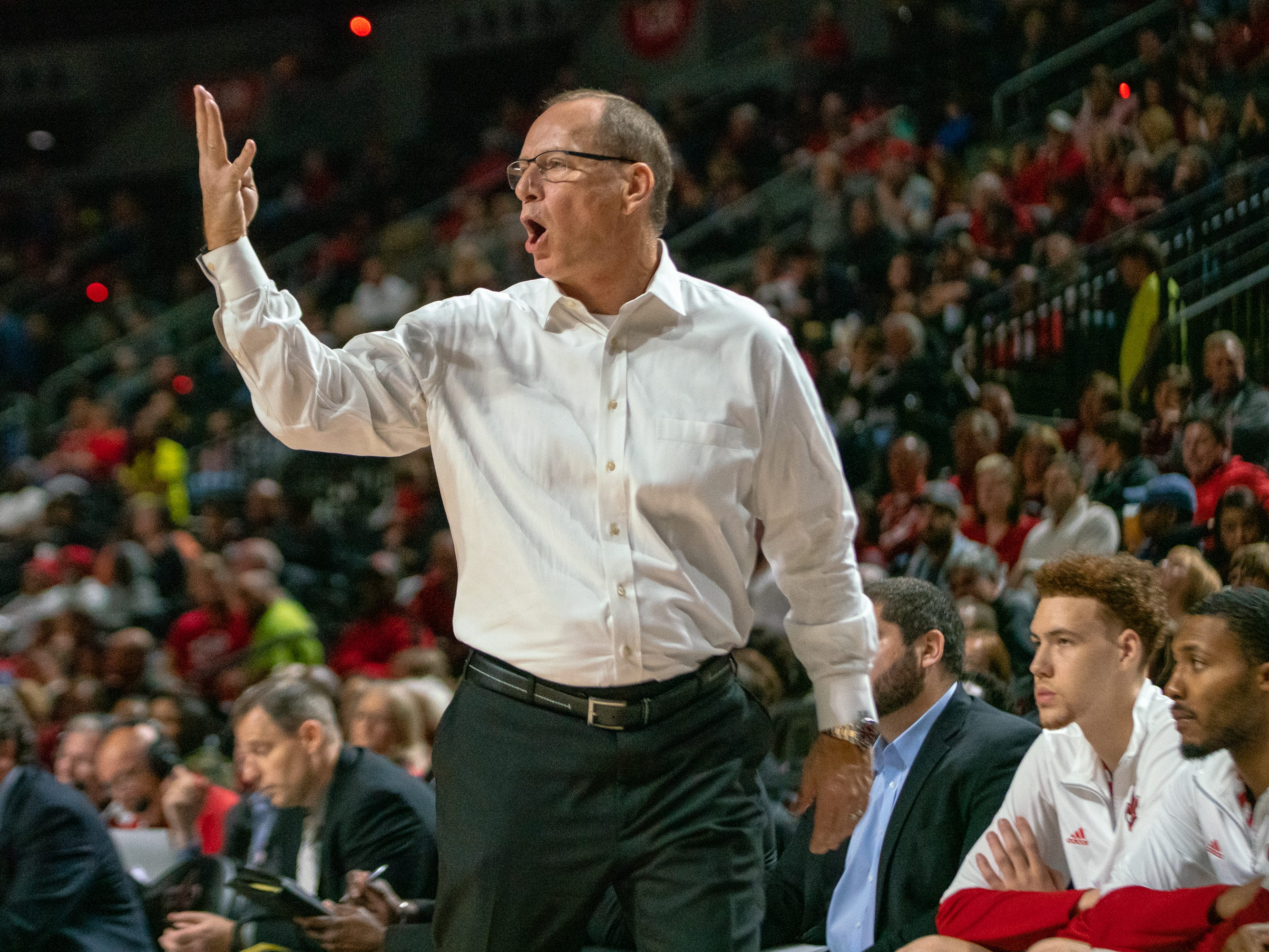UL's head basketball coach Bob Marlin calls a play from the sidelines as the Ragin' Cajuns take on the Troy Trojans at the Cajundome on Jan. 26, 2019.