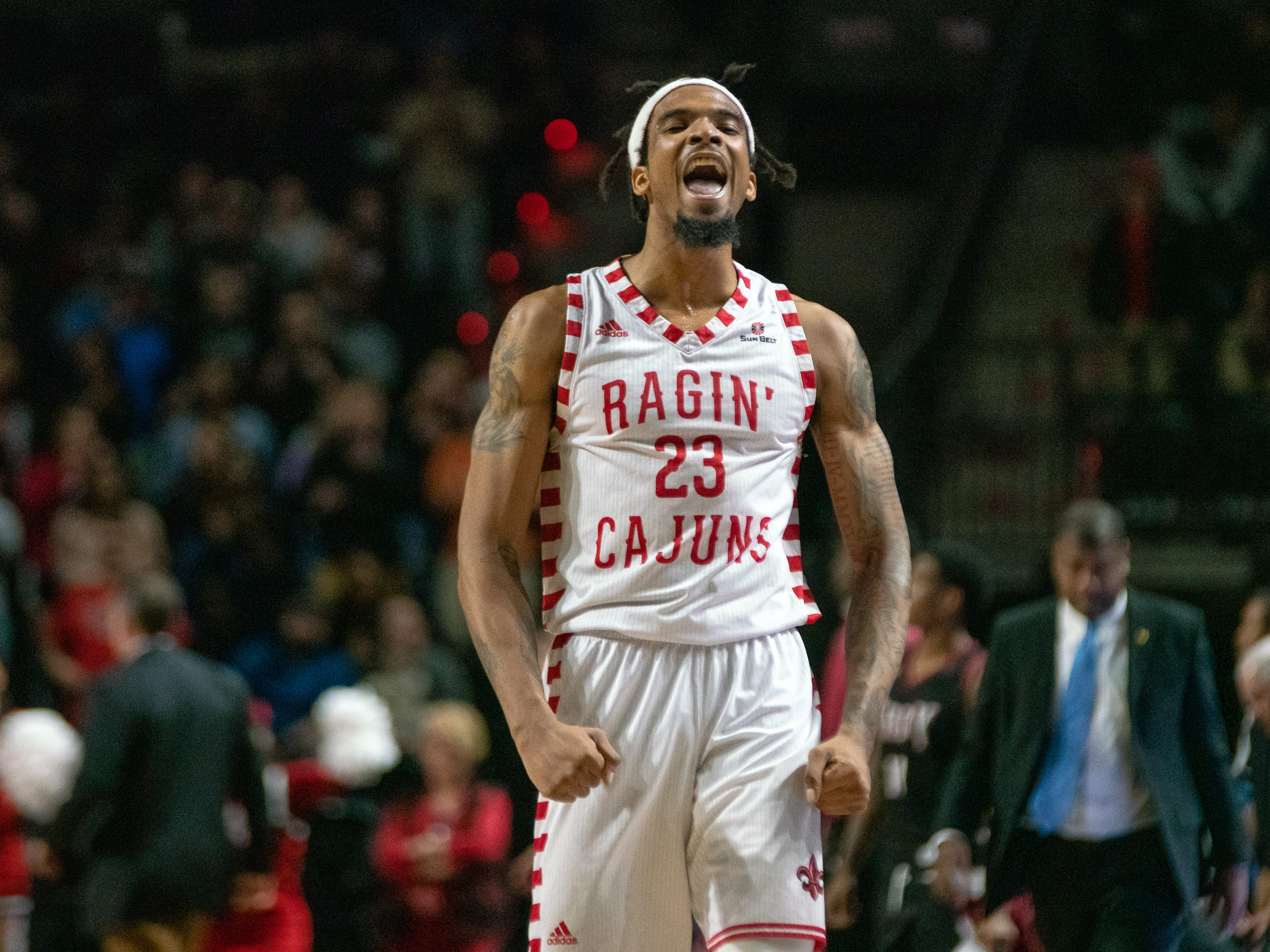 UL's Jakeenan Gant celebrates the win after the game as the Ragin' Cajuns take on the Troy Trojans at the Cajundome on Jan. 26, 2019.