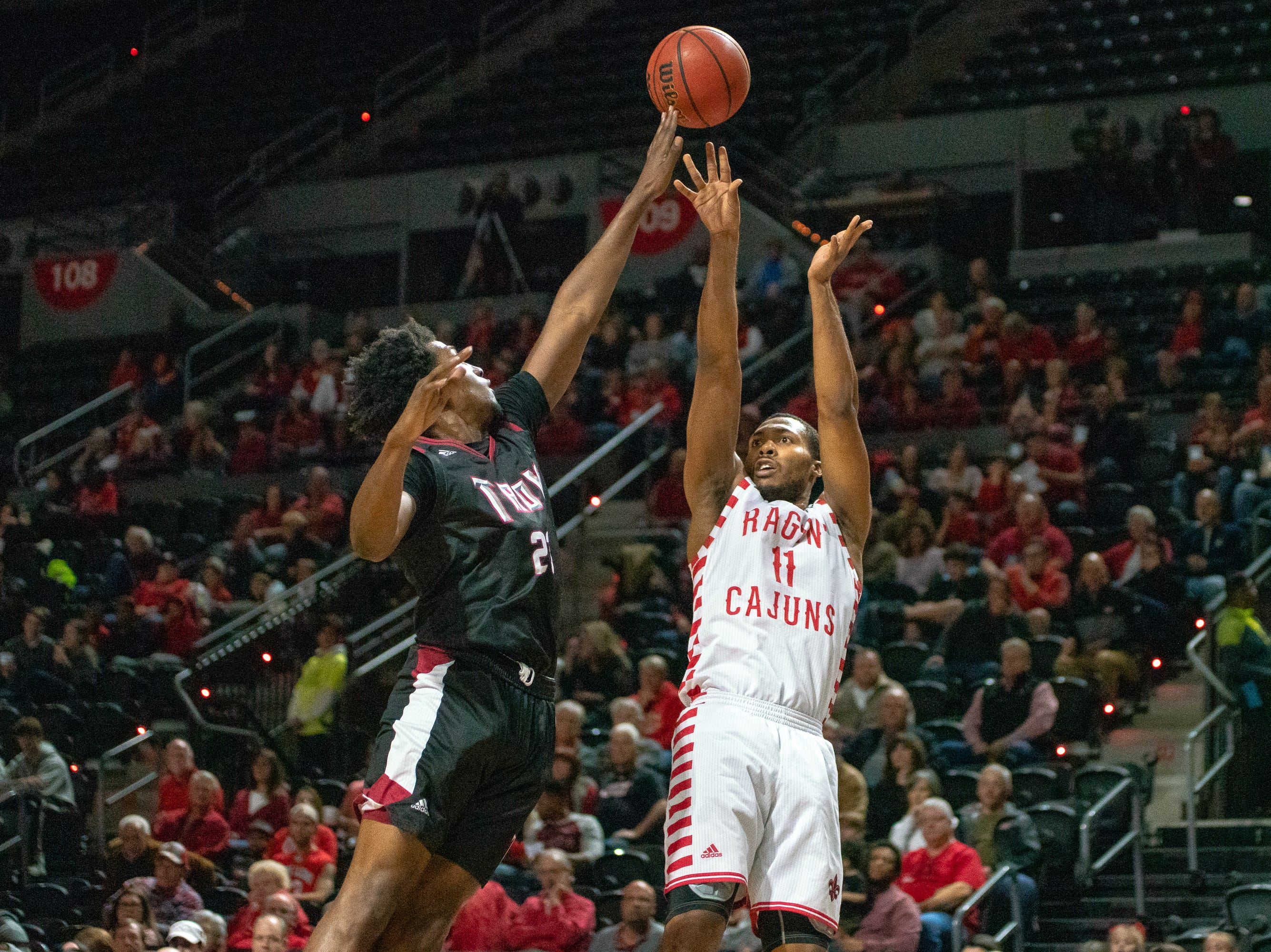 UL's Jerekius Davis (11) shoots from the three-point line as the Ragin' Cajuns take on the Troy Trojans at the Cajundome on Jan. 26, 2019.