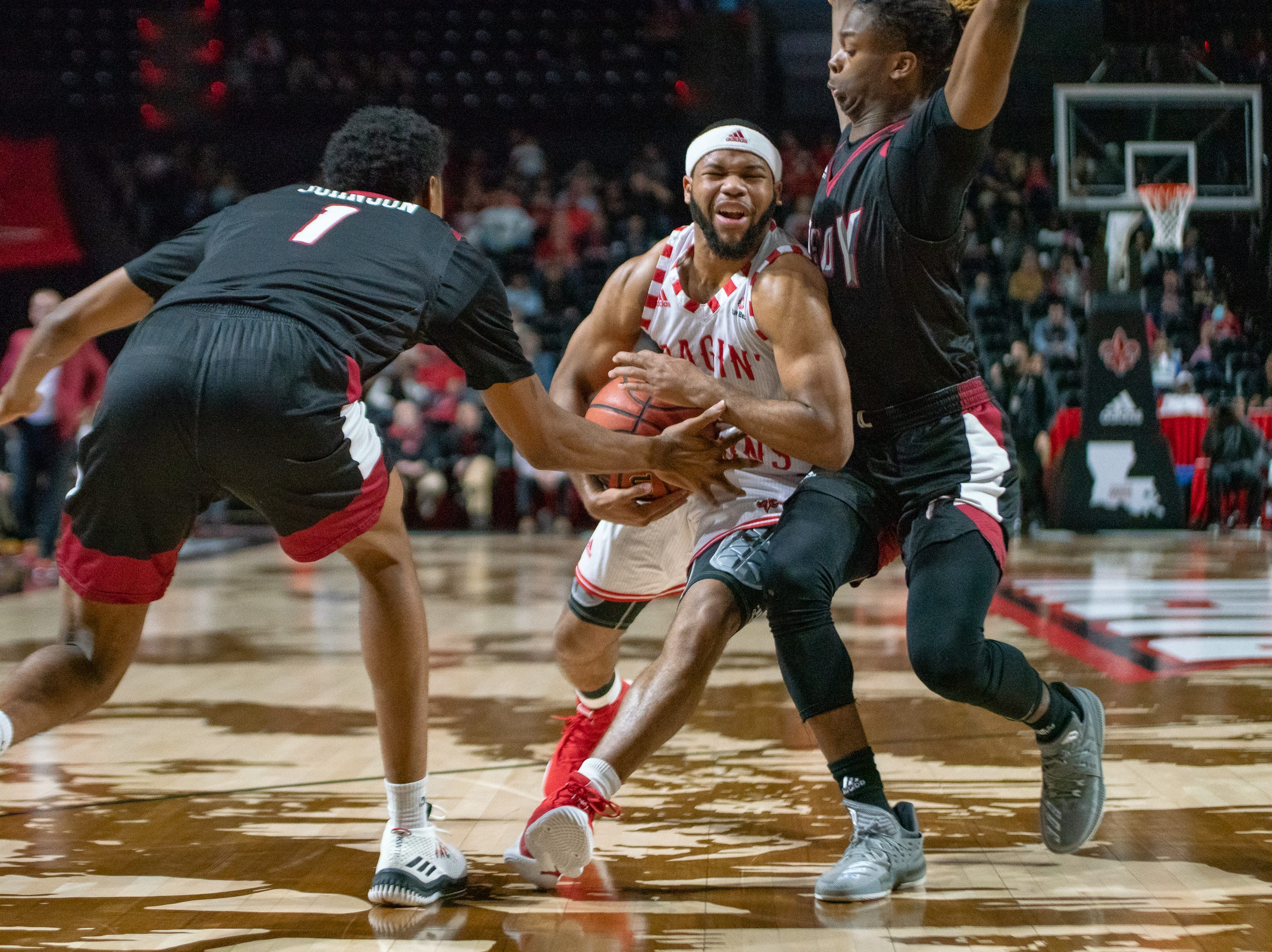 UL's Trajan Wesley drives the ball through the Troy defense as the Ragin' Cajuns take on the Trojans at the Cajundome on Jan. 26, 2019.