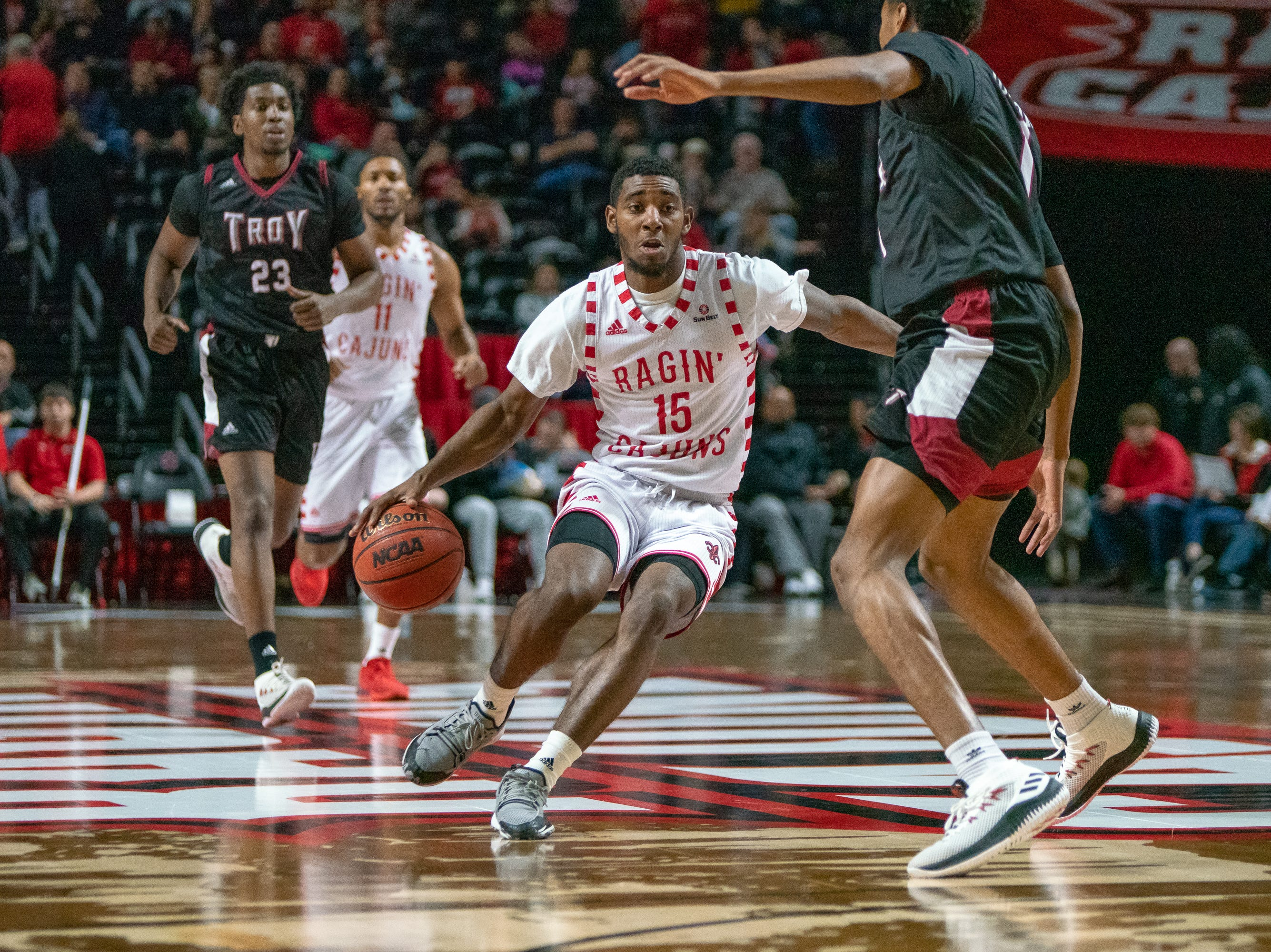 UL's P.J. Hardy (15) moves the ball down the court as the Ragin' Cajuns take on the Troy Trojans at the Cajundome on Jan. 26, 2019.