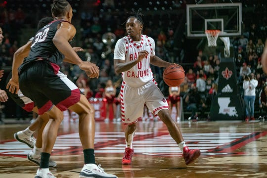 UL's Cedric Russell hit a pair of big 3-pointers during the stretch drive of the Cajuns' 86-81 home win over Troy on Saturday in the Cajundome.