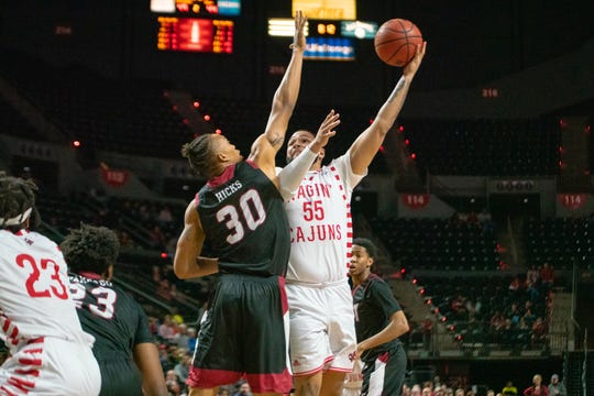 UL's Justin Miller uses a hook shot to score against Troy earlier this season.
