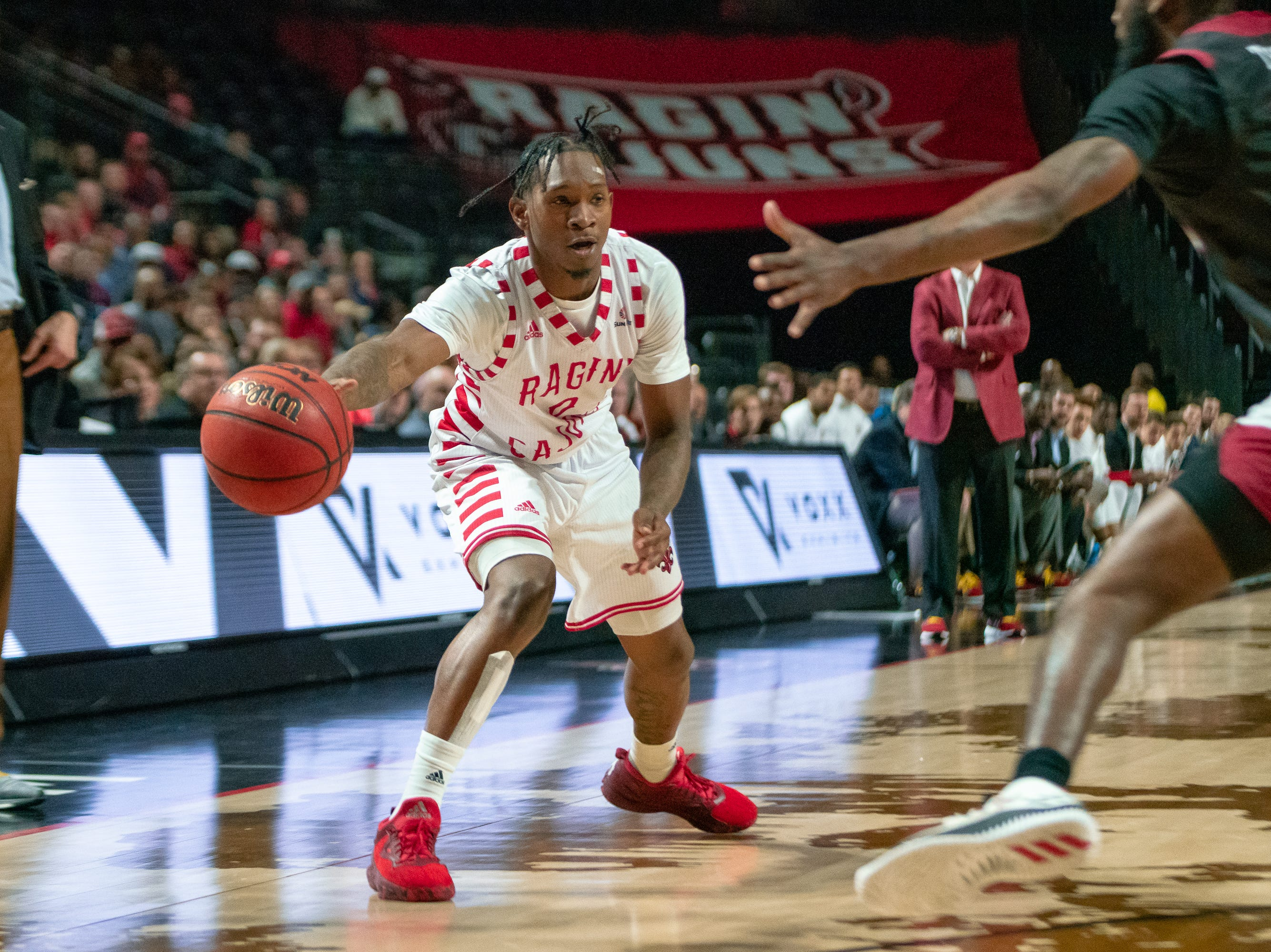 UL's Cedric Russell passes the ball to a teammate as the Ragin' Cajuns take on the Troy Trojans at the Cajundome on Jan. 26, 2019.