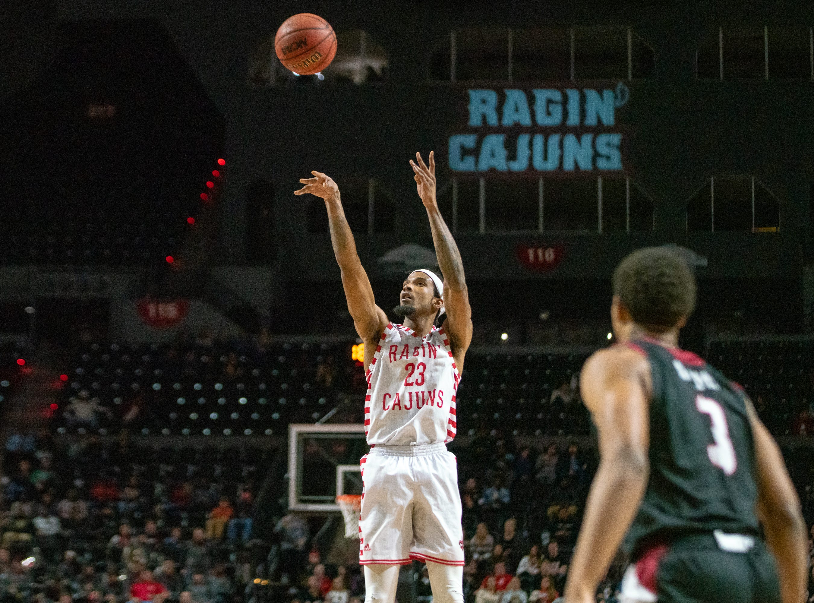 UL's JaKeenan Gant shoots to score a 3-pointer as the Ragin' Cajuns take on the Troy Trojans at the Cajundome on Jan. 26, 2019.