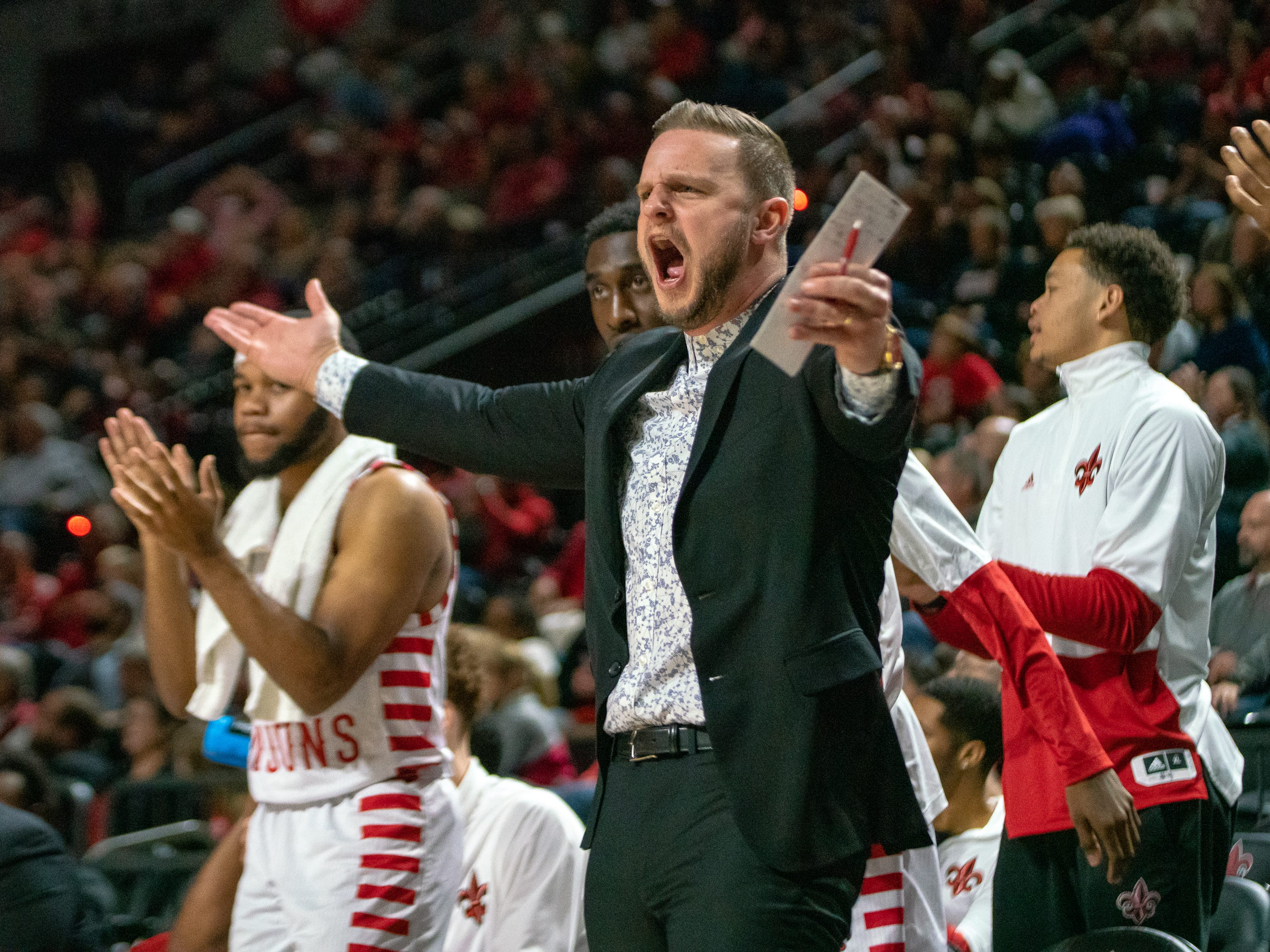 UL's Kyle Carrigee hypes up the bench after a successful play as the Ragin' Cajuns take on the Troy Trojans at the Cajundome on Jan. 26, 2019.