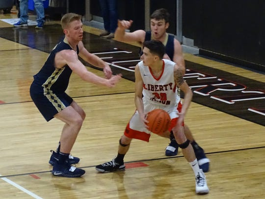 Liberty Union's Hunter Antritt looks for a teammate to pass the ball to against Teays Valley on Saturday. The Lions lost, 57-51.