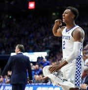 Kentucky's Ashton Hagans flexes as he watches Reid Travis score a basket against Kansas Saturday, January 26, 2019.
