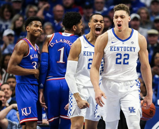 UK's PJ Washington (left) celebrates after a bucket by Reid Travis (right) in a January win over Kansas. Travis had 18 points and 12 rebounds.