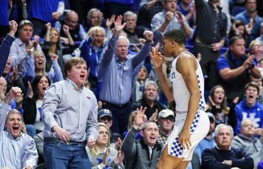 Kentucky's Keldon Johnson had 15 points including this second-quarter three-point shot that helped spark the Wildcats past Kansas Saturday night. January 26, 2019.