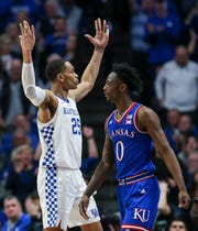 Kentucky's PJ Washington riles the fans in front of Kansas' Marcus Garrett as the Wildcats took a commanding lead Saturday night. Washington had 20 points and 13 rebounds. January 26, 2019.