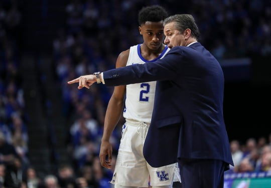 John Calipari talks with Ashton Hagans during the Wildcats' win over Kansas, Jan. 26, 2019.
