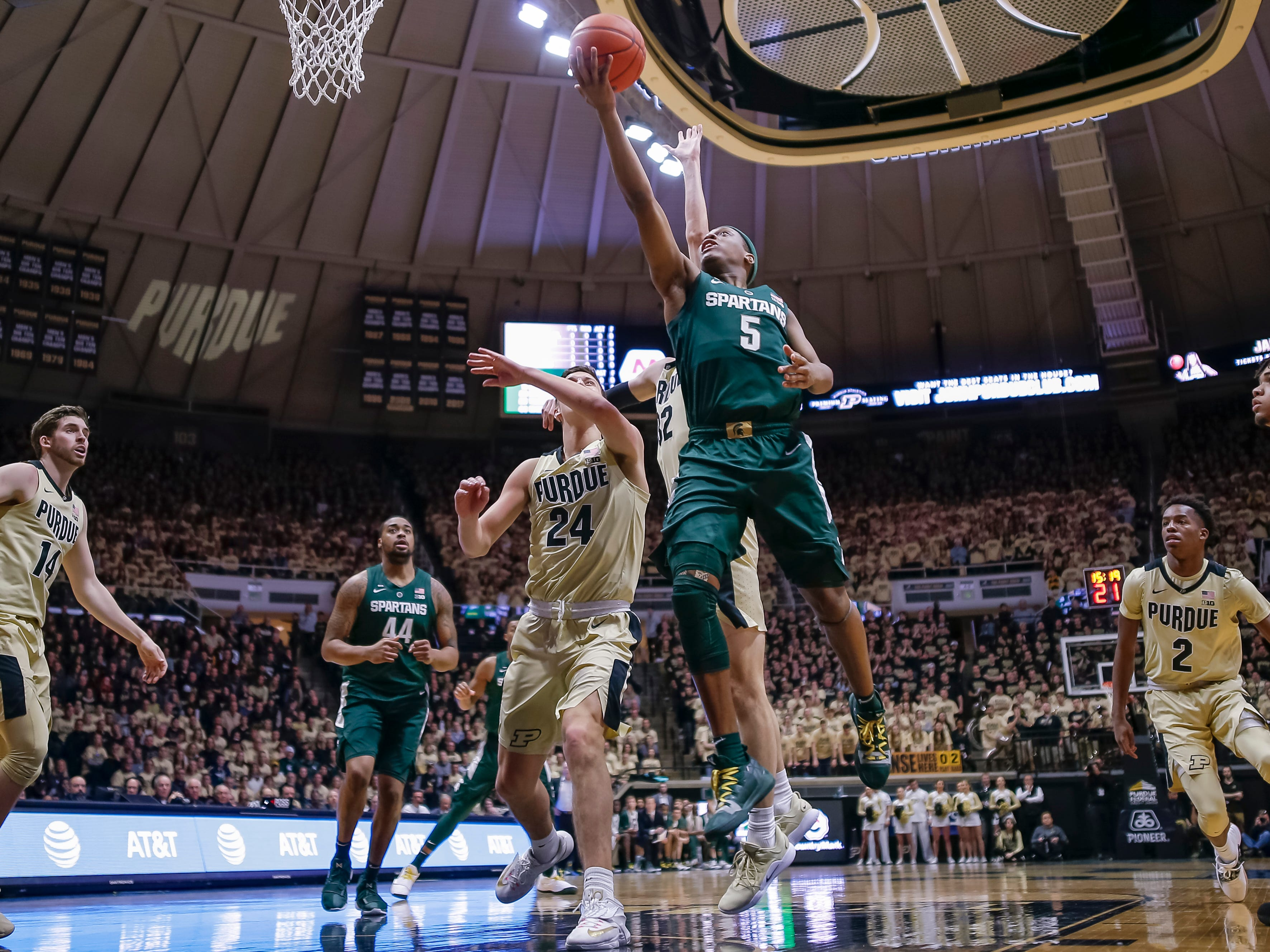 Cassius Winston #5 of the Michigan State Spartans shoots the ball over Grady Eifert #24 of the Purdue Boilermakers at Mackey Arena on January 27, 2019 in West Lafayette, Indiana.