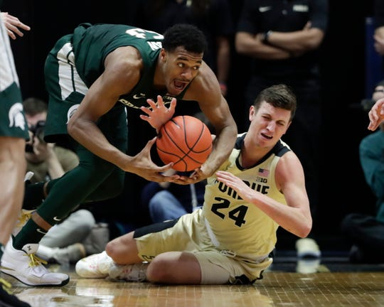 Purdue forward Grady Eifert (24) steals the ball from Michigan State forward Xavier Tillman (23) during the second half of an NCAA college basketball game in West Lafayette, Ind., Sunday, Jan. 27, 2019.