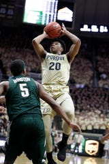 Purdue's Nojel Eastern shoots over Michigan State's Cassius Winston in the second half Sunday.