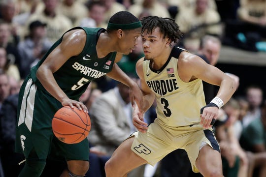 Michigan State's Cassius Winston, left, and Purdue's Carsen Edwards are the top two contenders for Big Ten Player of the Year honors at the midpoint of the conference regular season.