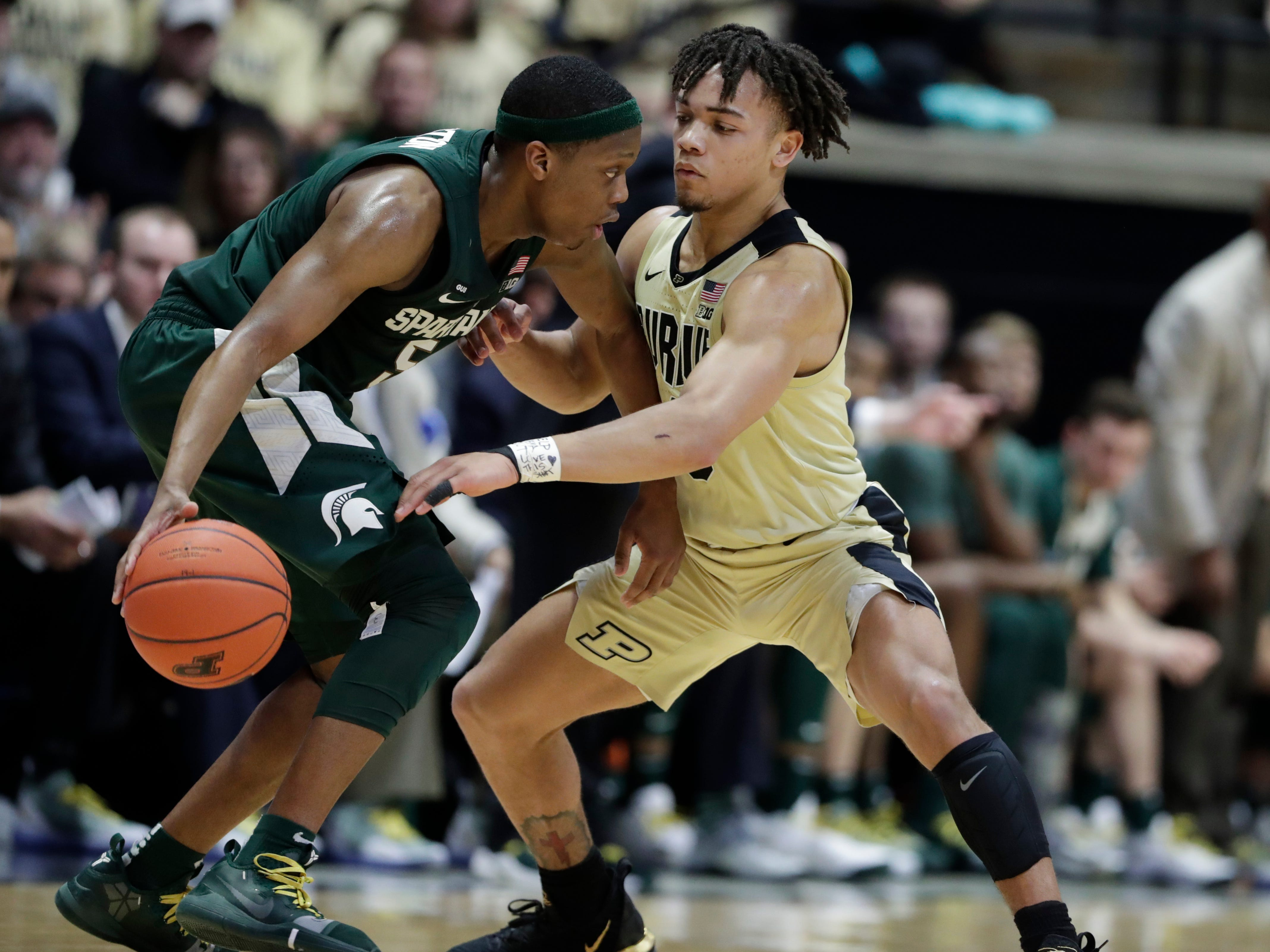 Purdue guard Carsen Edwards (3) defends Michigan State guard Cassius Winston (5) during the second half of an NCAA college basketball game in West Lafayette, Ind., Sunday, Jan. 27, 2019.