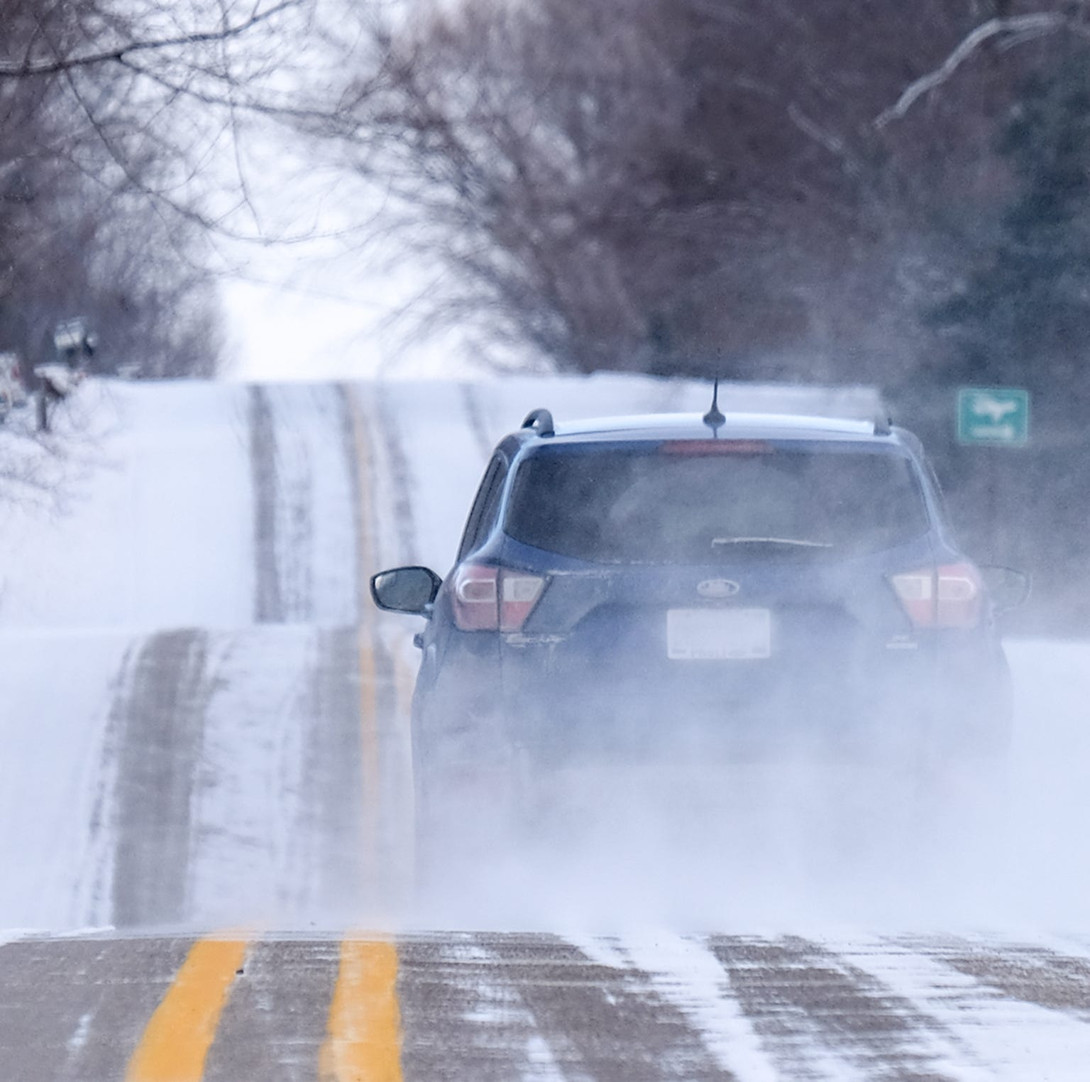 Lansing to miss worst of massive storm, but freezing rain will return
