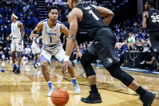 Memphis' Tyler Harris defends UCF's B.J. Taylor during Sunday afternoon's game.