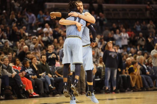 Memphis Grizzlies players Mike Conley and Marc Gasol embrace as they put the finishing touches on a 106-103 win over the Indiana Pacers at the FedExForum on Saturday, Jan. 26, 2019.