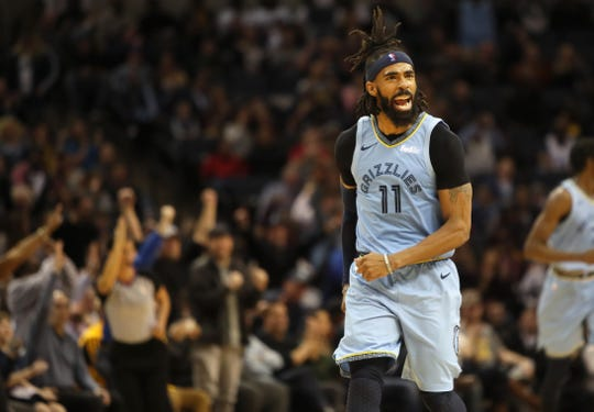 Memphis Grizzlies guard Mike Conley celebrates a made 3-pointer against the Indiana Pacers during their game at the FedExForum on Saturday, Jan. 26, 2019.