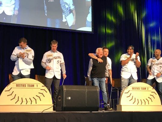 "Brewers players clap for Bob Uecker as he steps onto the stage for the ""Brewers Besties"" competition at the 2019 Brewers On Deck on Jan. 27, 2019. The Brewers broadcaster was surrounded by (from left) Brent Suter, Chase Anderson, Hernan Perez, Jesus Aguilar and Eric Thames."
