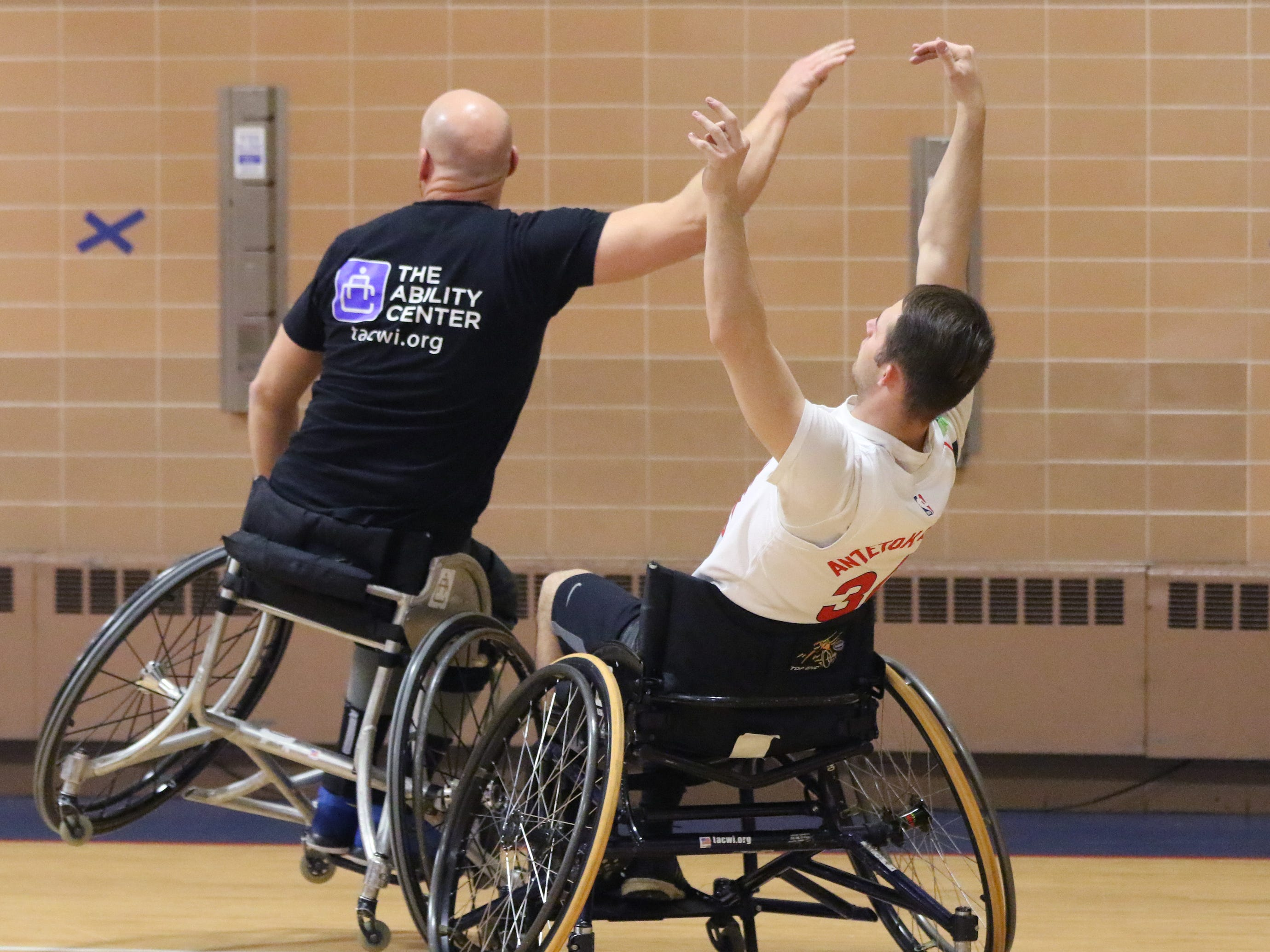 "Damian Buchman (left) blocks a pass to Mathew ""Turbo"" Turczyn while playing in the 3 vs. 3: Adult Wheelchair Basketball League with able bodied and mobility limited players at Jefferson Elementary School in Wauwatosa on Jan. 24."