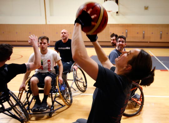 Rebecca Schlei fires for two points while playing in the 3 vs. 3: Adult Wheelchair Basketball League with able bodied and mobility limited players at Jefferson Elementary School in Wauwatosa on Jan. 24.