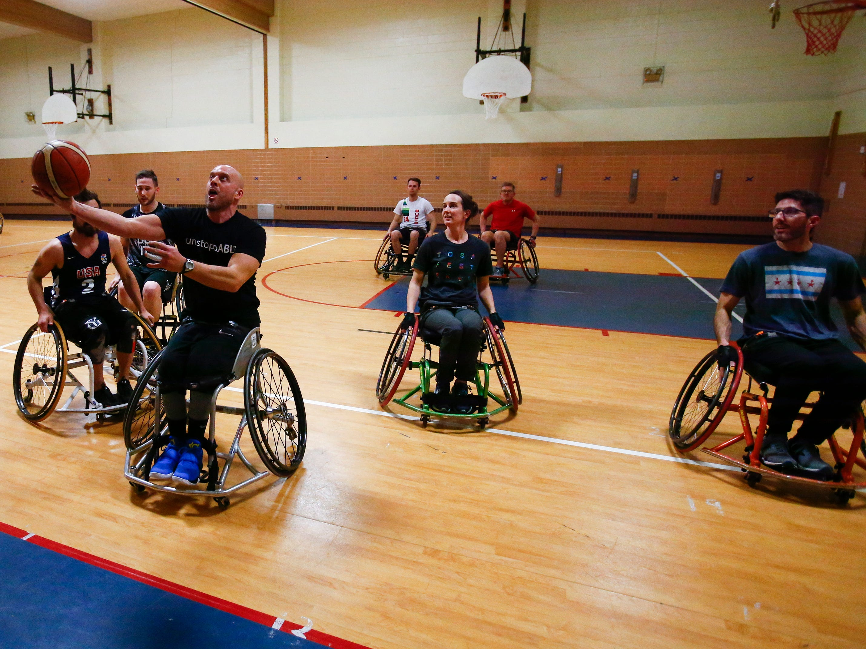 Damian Buchman fires for two points while playing in the 3 vs. 3: Adult Wheelchair Basketball League with able bodied and mobility limited players at Jefferson Elementary School in Wauwatosa on Jan. 24.