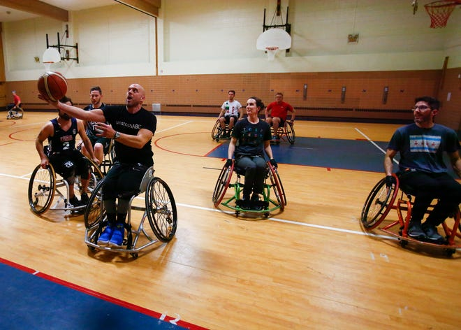 Damian Buchman, shown playing wheelchair basketball, is leading an effort to create an inclusive sports complex on Milwaukee's north side.