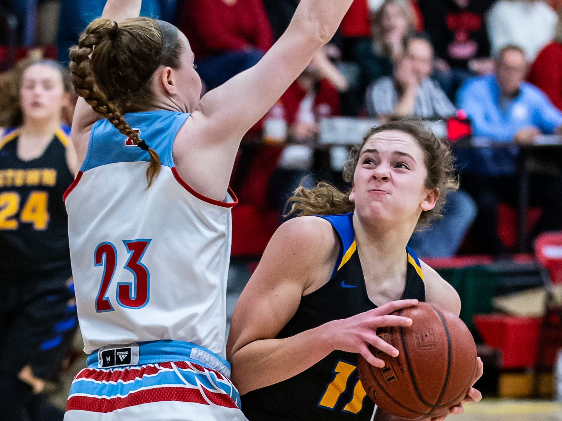 Germantown's Natalie McNeal (11) looks for a way around Arrowhead defender Bailey Deininger (23) during the game at Arrowhead on Saturday, Jan. 26, 2019.