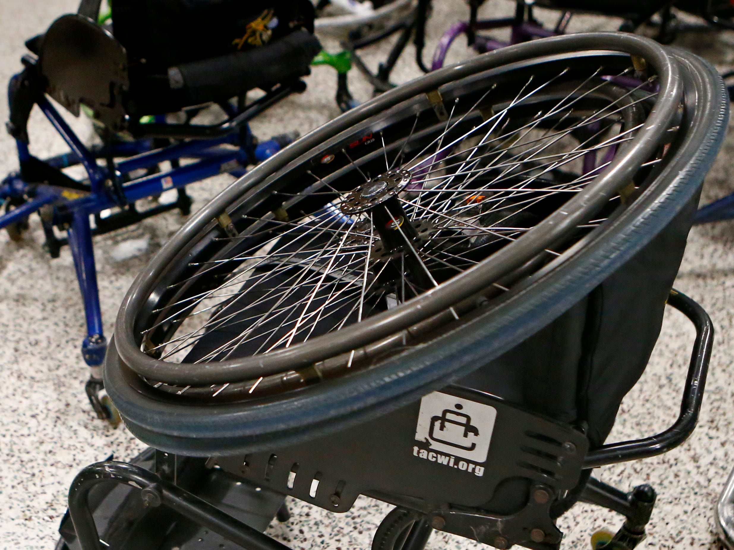 Sports wheelchairs await transport at the end of an eve of 3 vs. 3: Adult Wheelchair Basketball League with able bodied and mobility limited players at Jefferson Elementary School in Wauwatosa on Jan. 24.