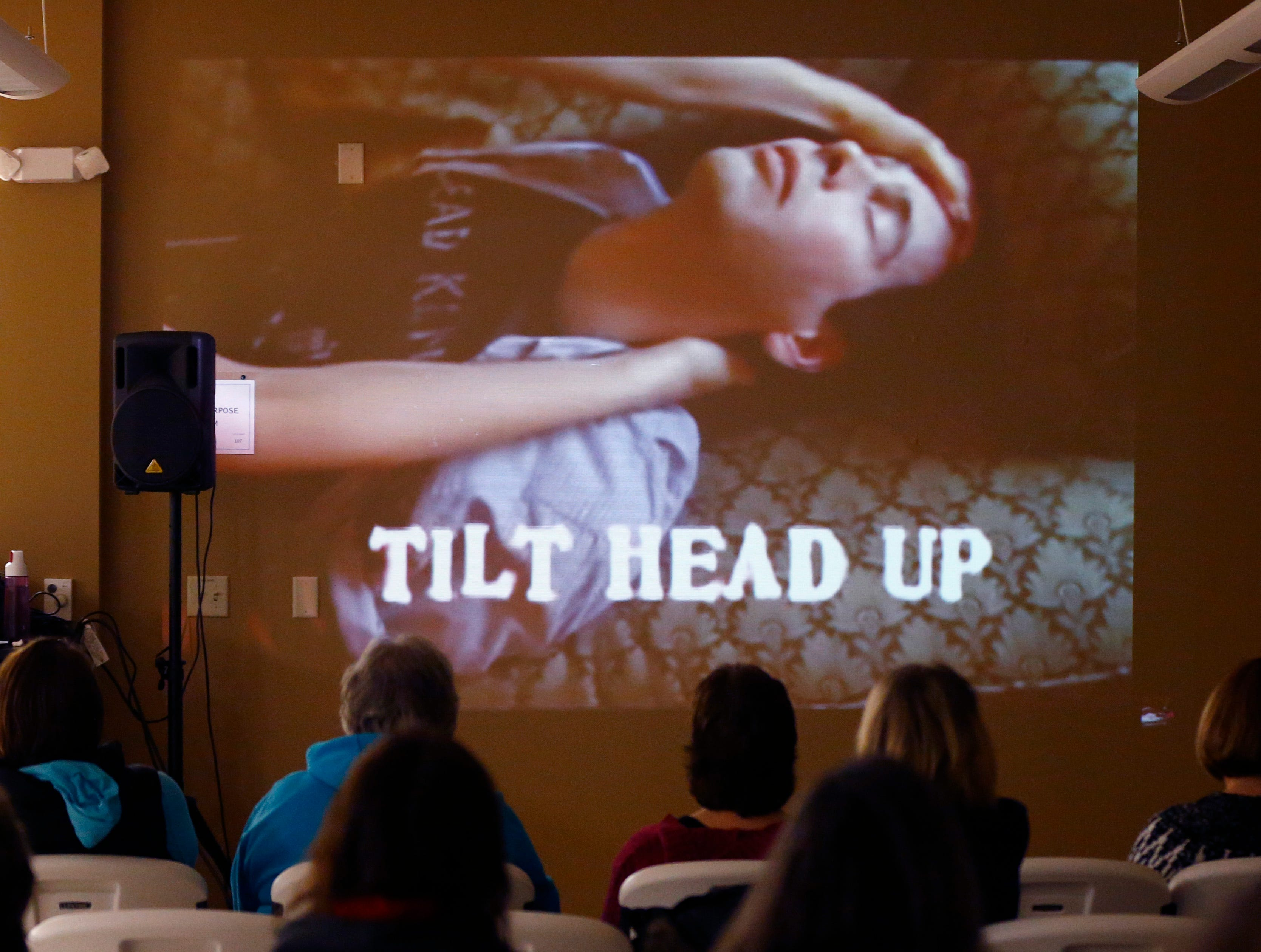 Students watch a video that shows the steps to administer Narcan to counteract an opiate overdose during workshop at the Salvation Army's Greenfield facility on Jan. 24.